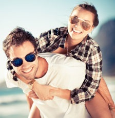 image of man and woman wearing sunglasses.